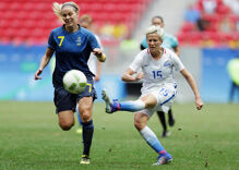 Opposing team prevents lesbian soccer star from kneeling before National Anthem