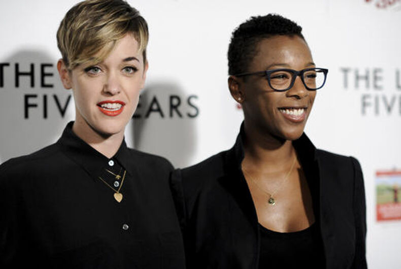 FILE - In this Feb. 11, 2015, file photo, Lauren Morelli, left, and Samira Wiley arrive at the LA Premiere of