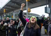 US judge temporarily bars deportations under Trump's anti-Muslim travel ban