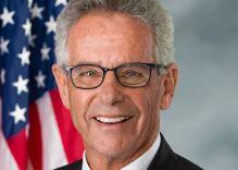 Man pulls down Congressman's rainbow flag and stomps on it