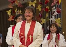 A Methodist bishop is on trial because she's a lesbian