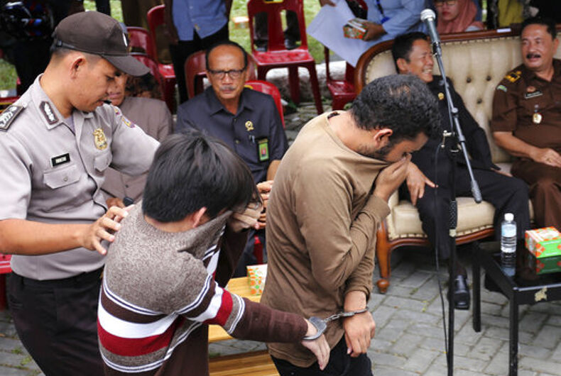 Gay men caned dozens of times in front of a cheering crowd in Indonesia