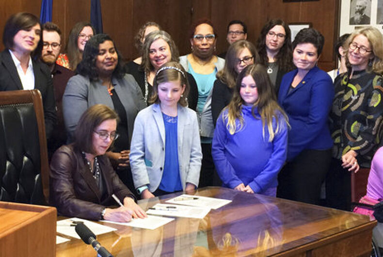 Oregon governor signs transgender rights bill into law