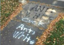 Racists target white gay & lesbian couples' homes for graffiti