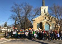 This guy saw 7 antigay protesters outside a church, so he called a few friends for help