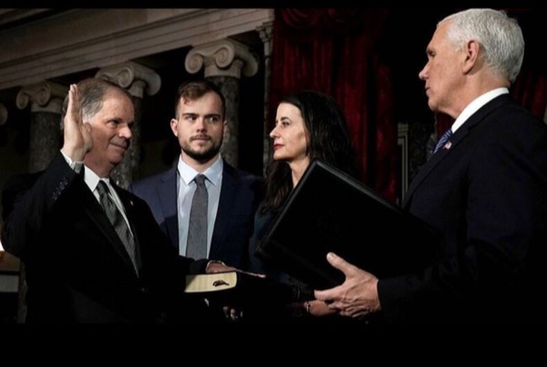 Queer media went nuts for Doug Jones' gay son giving Pence side-eye but they missed the best part