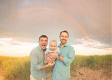 Gay couple announces they're having triplets with an adorable reveal