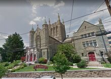 Who hung an antigay banner on this Catholic Church?