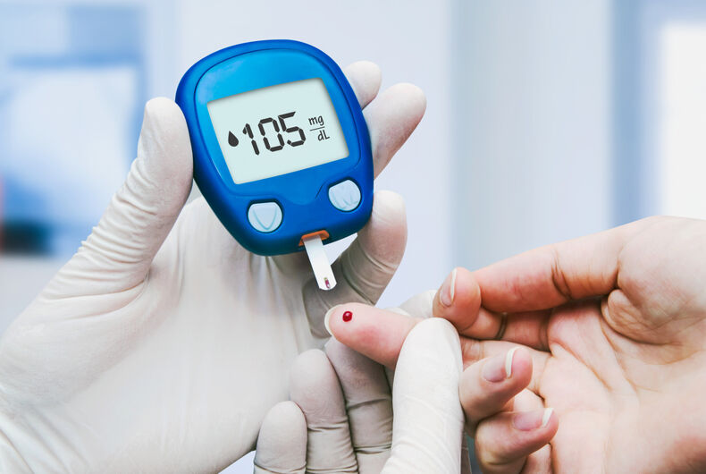 Doctor making blood sugar test in clinic for diabetes.