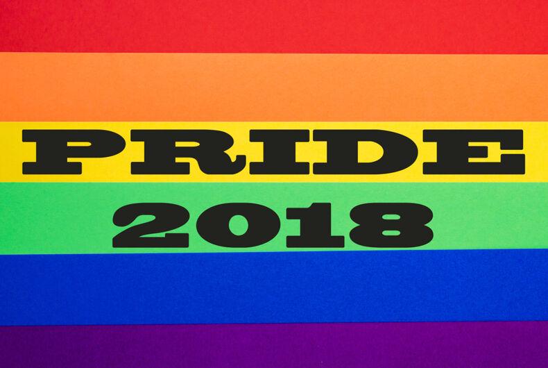Pride 2018 overlaid on a rainbow flag