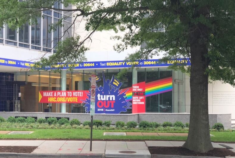 The front entrance of the Human Rights Campaign's DC headquarters now includes a rainbow flag window cling. The flag is a recent version with brown and black stripes.