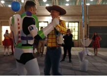 This gay couple got married as Sheriff Woody & Buzz Lightyear & their family dressed up, too!