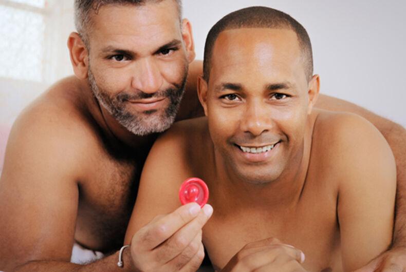Men holding a condom