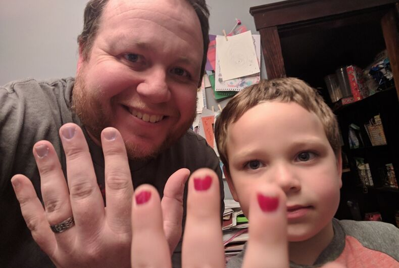 Dad and son show off their nail polish.