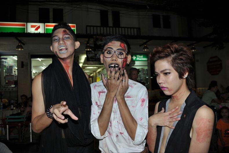 Three Halloween revelers