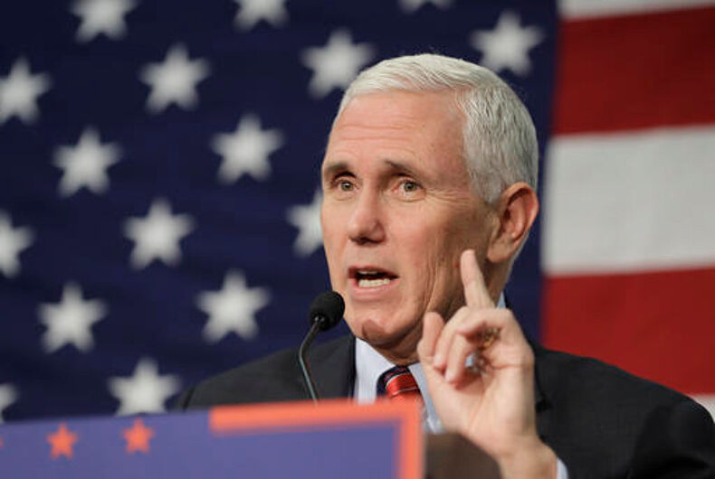 """In this Sept. 30, 2016 file photo, Republican vice presidential candidate, Indiana Gov. Mike Pence speaks in Fort Wayne, Ind. Pence musters all of his Midwestern earnestness as he describes Donald Trump as """"a man of faith."""" He says the Republican nominee is """"a man I've prayed with and gotten to know on a personal level."""""""