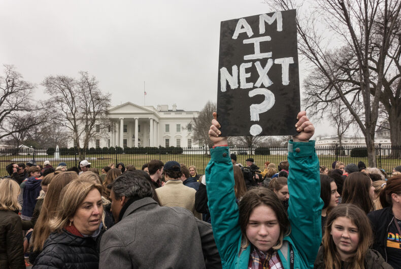 WASHINGTON, DC - FEB 19, 2018: Demonstrators in front of the White House protest the federal government's inaction on gun control following a deadly shooting in a south Florida high school.