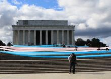 Activists unfurled a gigantic trans flag on the steps of the Lincoln Memorial