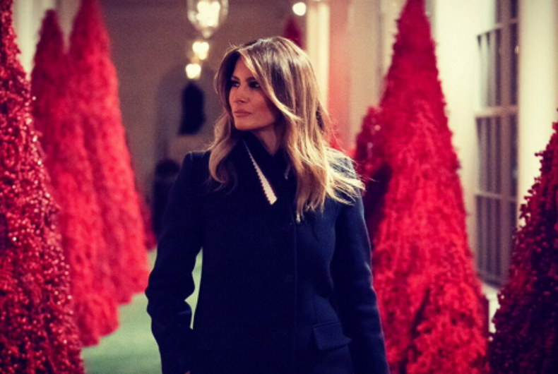 First Lady Melania Trump poses with this year's Christmas decorations.