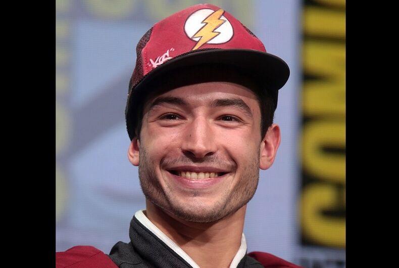 Ezra Miller in a red cap.