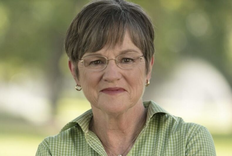 Laura Kelly in front of a green background