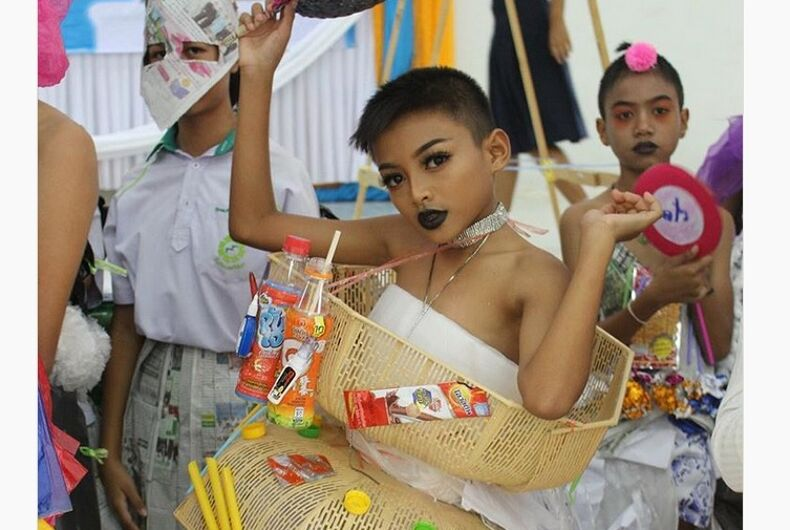 A boy wearing plastic baskets and various food items as drag