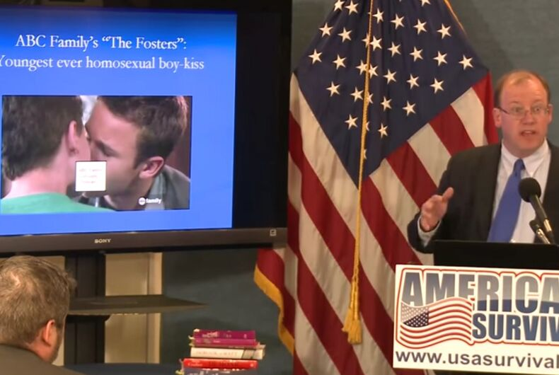 Peter LaBarbera at a lecturn with an American flag behind him. Next to him is an image of two men kissing, partly censored.