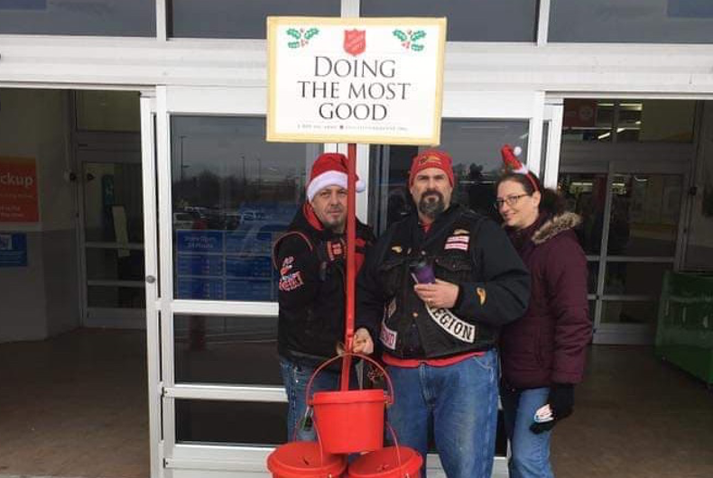 Members of the Hells Angels Northwest Indiana Region Motorcycle Club stand behind the Salvation Army's iconic red kettle.