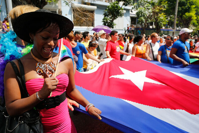 A group of people carrying a Cuban flag