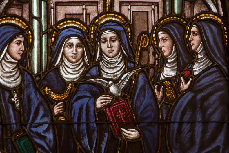 BRISTOW, VIRGINIA - APRIL 26, 2015: Stained glass window depicting five Benedictine female saints, Saints Hildegard, Walburga, Scholastica, Mechtild, and Gertrude, located at St. Benedict Monastery