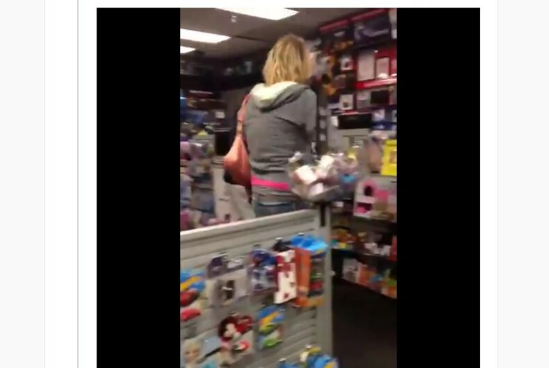 A tweet with the image of a woman at a video game store.