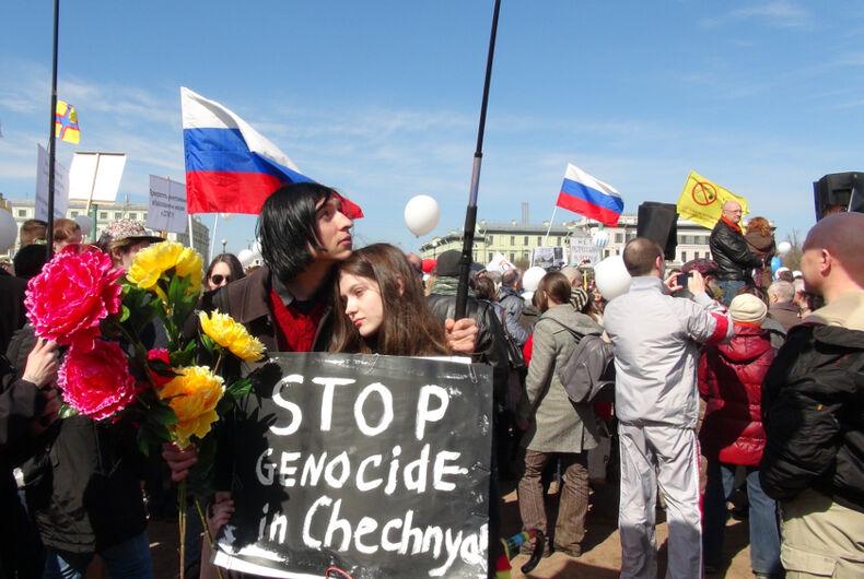Russia, anti-LGBTQ purge, crackdown, Chechnya, protest, Russia, protestors, couple, gay