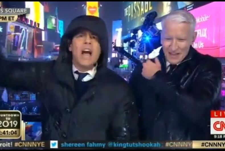 Andy Cohen and Anderson Cooper hosting CNN's annual New Years Eve broadcast from Times Square.
