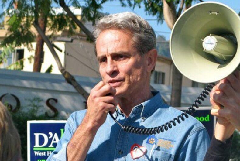 Ed Buck holding a megaphone