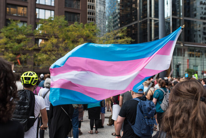 CHICAGO, ILLINOIS - AUGUST 21, 2017: Transgender pride flag waving in the wind during a protest against white supremacy and discrimination after the events in Charlottesville, Virginia.