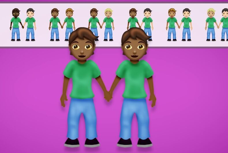 Two women holding hands emoji