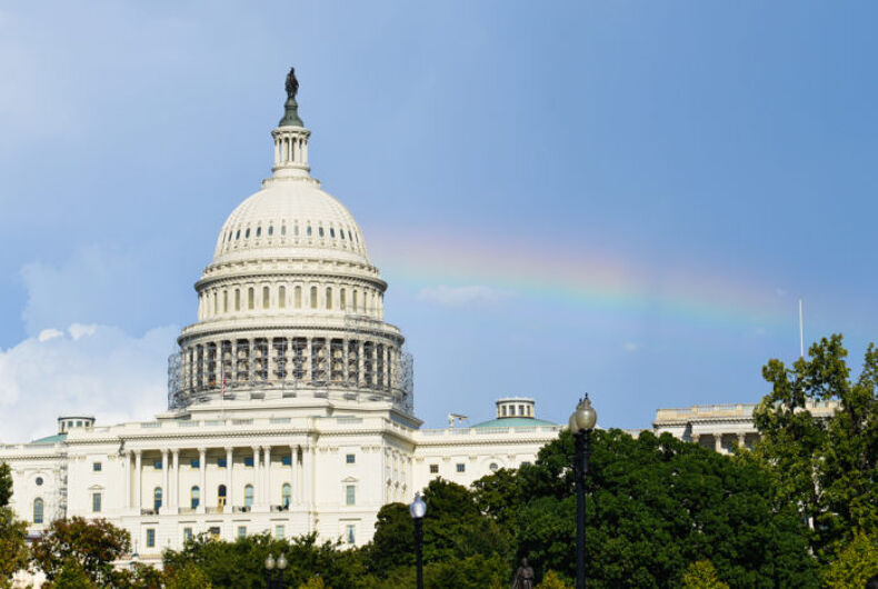The Capitol with a rainbow behind it.
