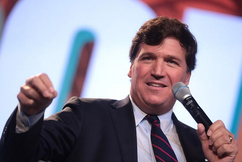 Tucker Carlson with a mic