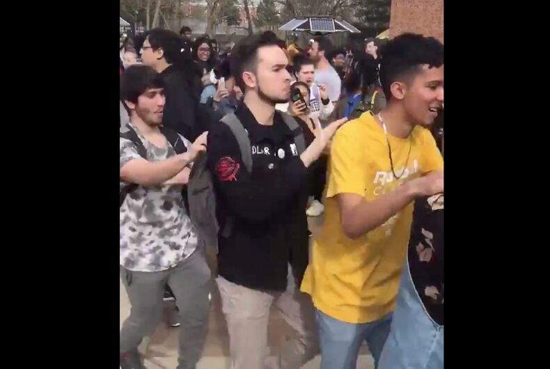 Students at Rowan University drowned out anti-LGBTQ protesters with a conga line dance party.