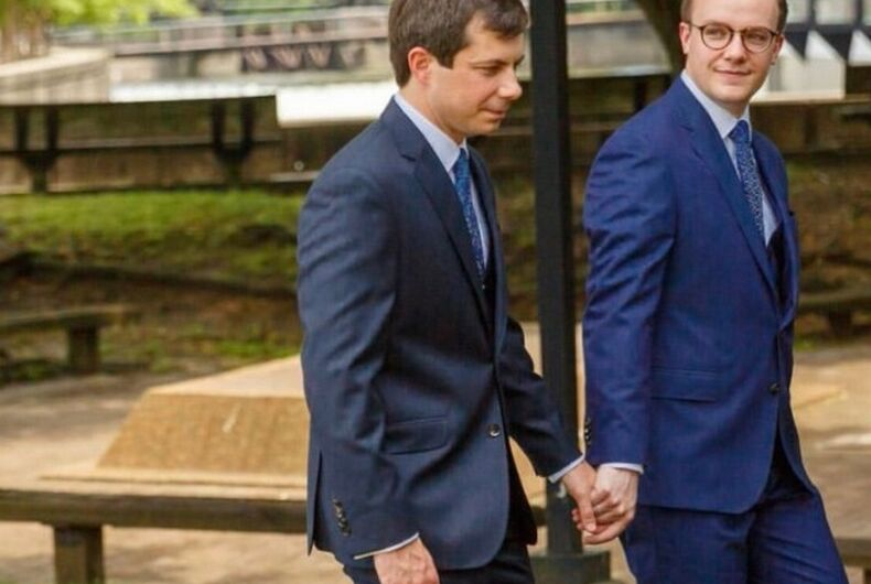 Pete and Chasten holding hands