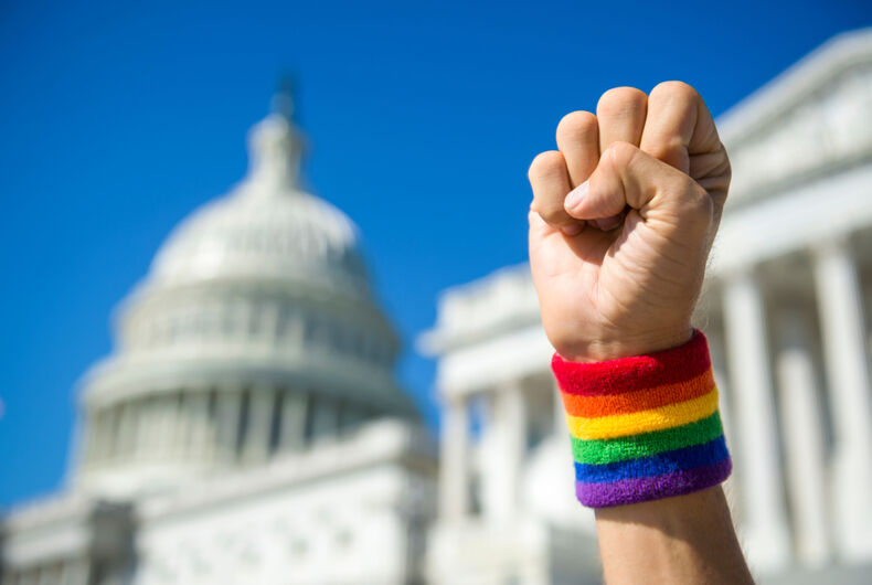 rainbow fist in front of capitol