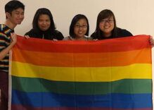 Security guards confiscate rainbow flags from fans at a gay musician's concert