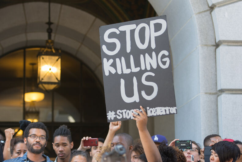 July 12, 2016 - Black Lives Matter protestors holding a poster during a march on City Hall following the fatal shooting of African American female Redel Jones by LAPD.
