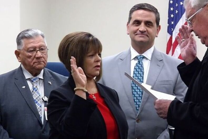 Carolyn Vaughn being sworn in as County Commissioner