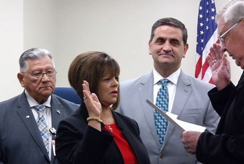 Carolyn Vaughn being sworn in as County Commissioner