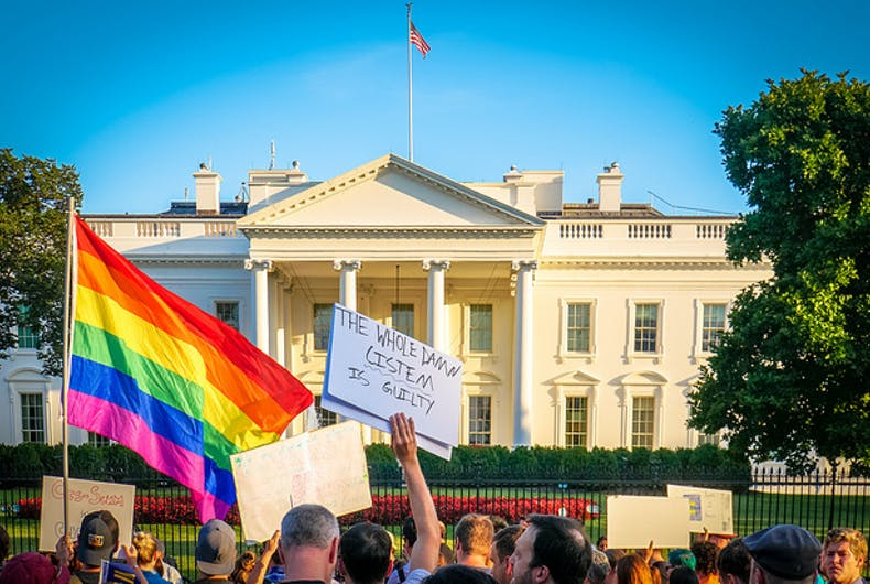 Protest at White House with a rainbow flag