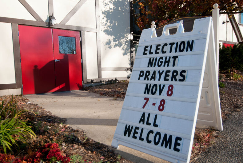 A sign for election night prayers at the Church of Our Savior in Milford, New Hampshire.