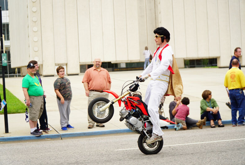 9/28/2018: An Elvis impersonator pops a wheelie during the Texas State Fair parade.