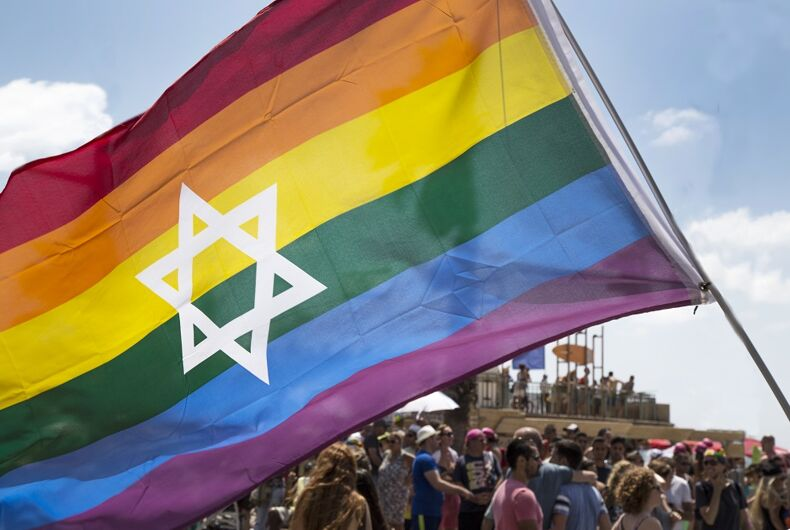 The pride flag with a Star of David on it
