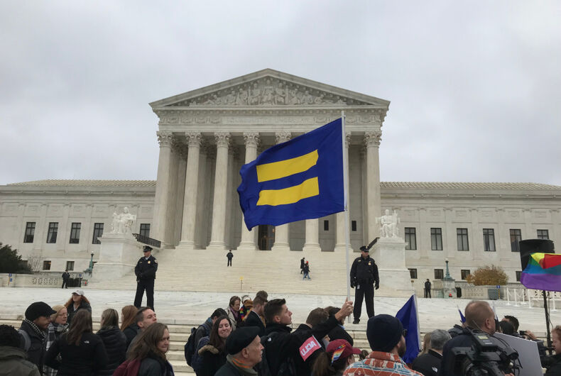 Human Rights Campaign flag being waved at the Supreme Court on December 5, 2017